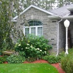 Elite Blue Granite Tumbled Ledgerock house side