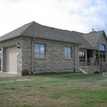 brown limestone ledgerock house finished garage