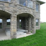 brown limestone ledgerock house finished pillars