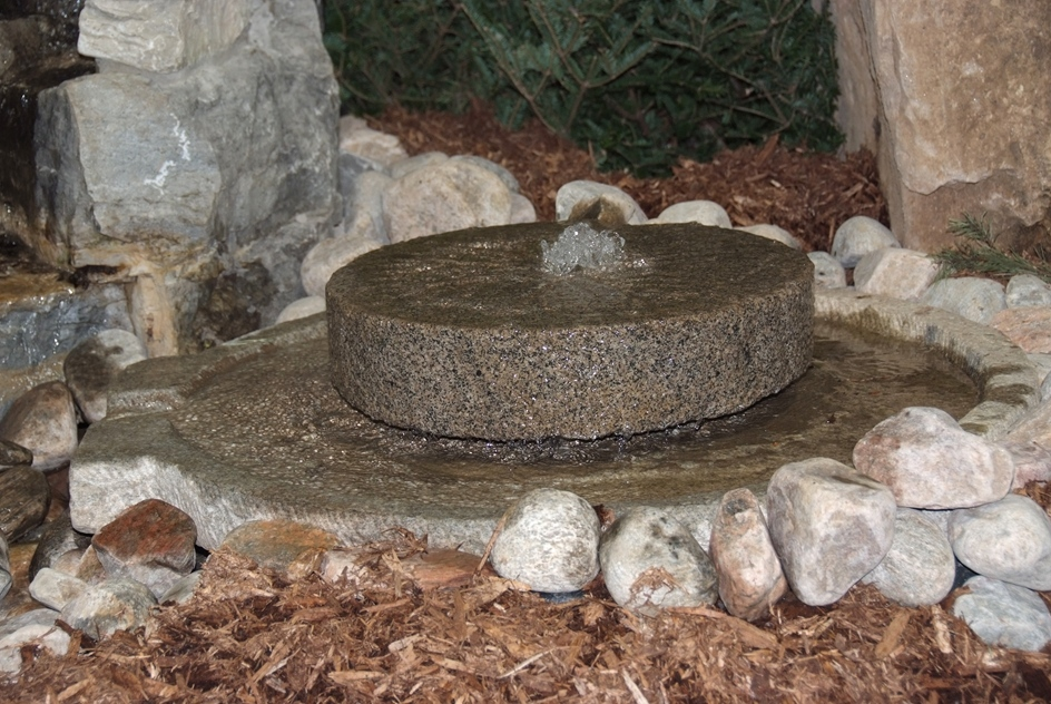 Mill Stone Water Feature on a Mill Stone Base