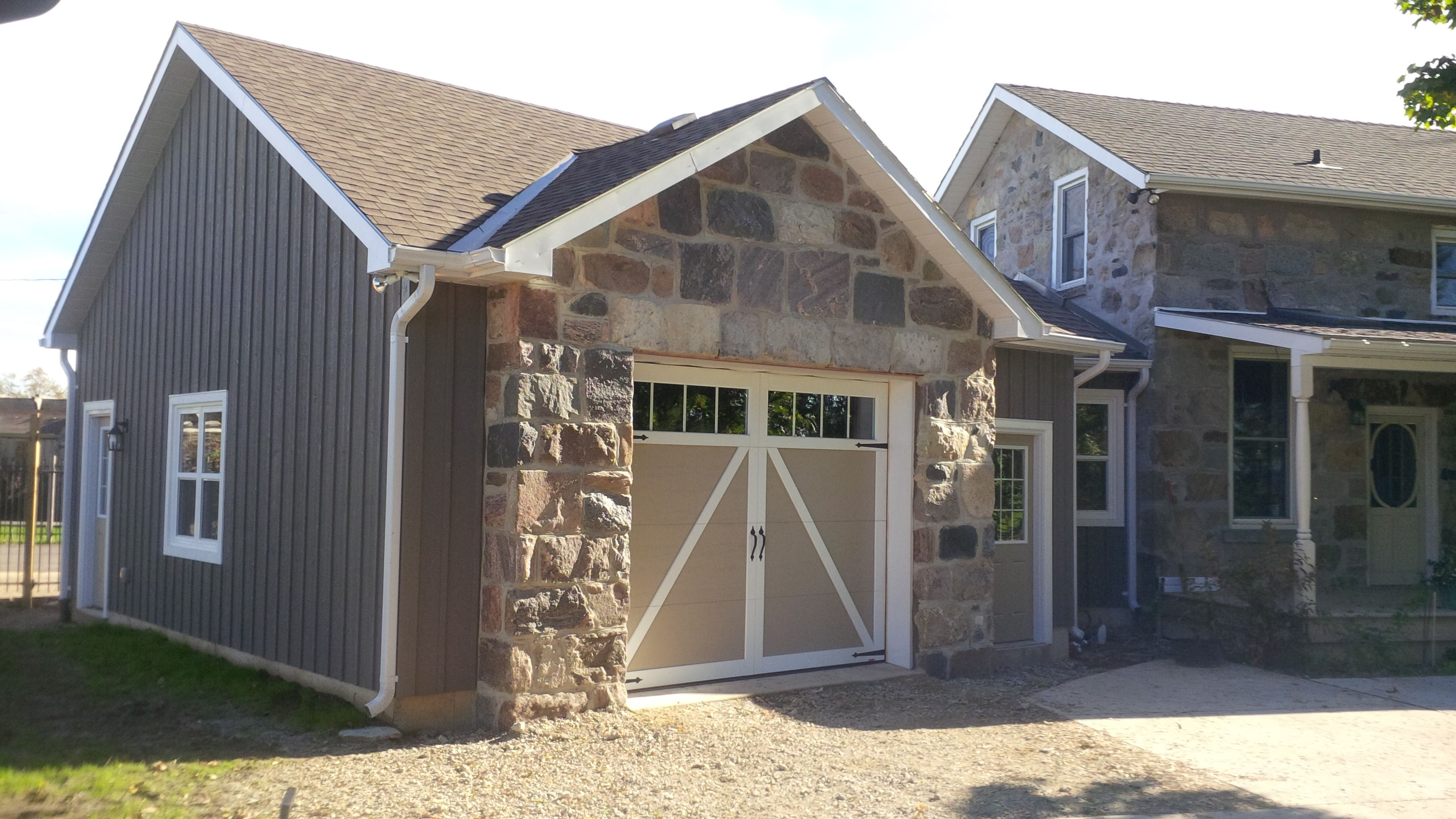 split fieldstone squared garage and house