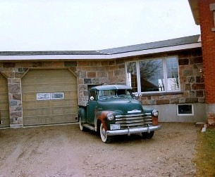 split fieldstone squared garage
