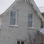 white to grey limestone house closeup
